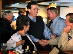 "Rick Santorum greets people during a ""Faith, Family and Freedom"" campaign event at Percy & Willie's Food and Spirits restaurant Sunday in Florence, S.C."