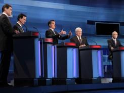 GOP presidential candidates, from left, Rick Perry, Rick Santorum, Mitt Romney, Newt Gingrich and Ron Paul spar during Monday's debate in Myrtle Beach, S.C. They are scheduled for another debate Thursday in Charleston, S.C.