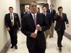 House Speaker John Boehner walks to a news conference on the payroll tax cut with House Majority Leader Rep. Eric Cantor, right, on Dec. 22, 2011, on Capitol Hill.