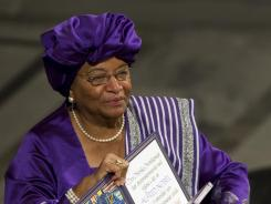 2011 Nobel Peace Prize laureate Liberian President Ellen Johnson Sirleaf poses with her medal and certificate on Dec. 10.