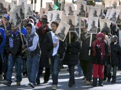 Hundreds of people walk down Fayetteville Street on Monday during the annual Martin Luther King Memorial March.