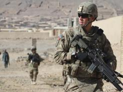 U.S. soldiers with the NATO- led International Security Assistance Force are seen during a foot patrol in Kandahar, south of Kabul, Afghanistan, on Jan. 7.