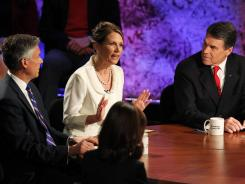 From left, Jon Huntsman, Michele Bachmann and Rick Perry debate Oct. 11 at Dartmouth College in Hanover, N.H. All three pulled out of the GOP presidential contest.