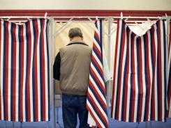 A man votes in the New Hampshire primary in Bedford on Jan. 10.
