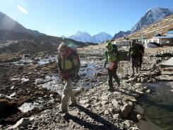 Visitors trek on a trail of the Everest region, northeast of Katmandu, Nepal. The U.S. State Department warned travelers that Nepali police have reported more sexual assaults involving foreigners.