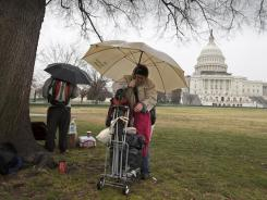 Occupy Congress protesters arrive for demonstrations and activities Tuesday on Capitol Hill.