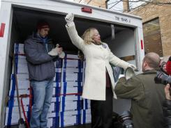 In Madison, Wis.:  Julie Wells celebrates Tuesday the delivery of petitions to recall the governor.