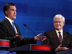 Mitt Romney and Newt Gingrich participate in a GOP presidential debate in Myrtle Beach, S.C., on Monday.