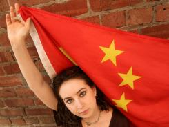 Studied in China: Melissa Sconyers with a Chinese flag in San Francisco in 2008.