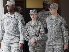Pfc. Bradley Manning, center, shown after a December proceeding, is one step closer to a court-martial.