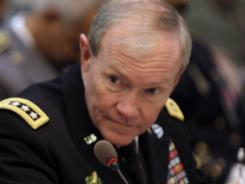 U.S. General Martin Dempsey listens during a Wednesday meeting of NATO Military Chiefs of Staff at NATO headquarters in Brussels.