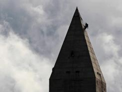 Engineers inspect the Washington Monument on Sept. 28  for damage caused by an earthquake a month earlier.