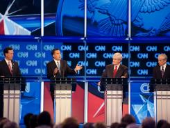 From left: Rick Santorum, Mitt Romney, Newt Gingrich and Ron Paul participate in Thursday night's GOP presidential debate in Charleston, S.C.