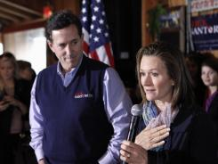 GOP presidential hopeful Rick Santorum and his wife, Karen, campaign in Lexington, S.C., on Friday.