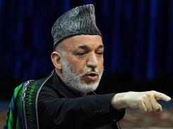 Afghan President Hamid Karzai speaks during a tribal meeting in Kabul on November 19.