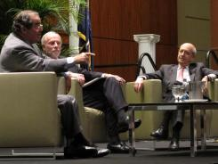 U.S. Supreme Court Justices Antonin Scalia, left, and Stephen Breyer, right, talk to moderator Charles Bierbauer, center, at a debate before the South Carolina Bar in Columbia, S.C., on Saturday.