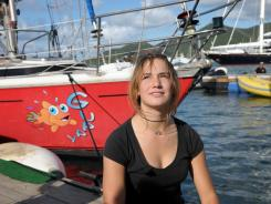 Laura Dekker, 16, arrives at St. Maarten Yacht Club in the Dutch Caribbean island of Sint Maarten on Saturday.