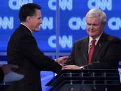 Presidential candidates Mitt Romney, left, and Newt Gingrich shake hands at the end of Thursday's Republican debate in Charleston, S.C.