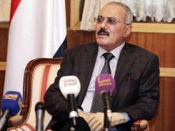 Yemen's President Ali Abdullah Saleh speaks to state media reporters at the Presidential Palace in Sanaa, Yemen, on Sunday.