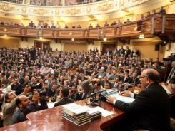 Saad el-Katatni, Egypt's newly elected parliament speaker, addresses the first session after the revolution that ousted Hosni Mubarak in Cairo on Monday.