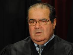 "Justice Antonin Scalia wrote that when police attach a GPS device to someone's property, it ""constitutes a search."""