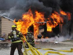 Firefighters battle a blaze from a shake-and-bake meth lab explosion on Jan. 29, 2010, at a house in Union, Mo.