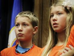 Wearing anti-bullying shirts: Students encourage Minnesota legislators in November to enact a law against bullying.