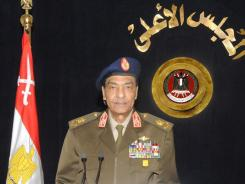 Field Marshal Hussein Tantawi announces the lifting of the decades-old state of emergency in a televised speech in Cairo on Tuesday.