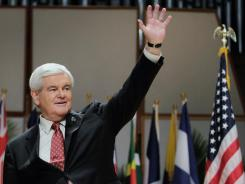 Newt Gingrich waves during a campaign event billed as a Latin American Policy Speech at Florida International University on Wednesday in Miami.