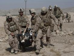 Marines carry a severely wounded colleague who was hit by an IED Oct. 31 in Afghanistan.