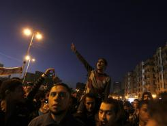 Protesters chant slogans Thursday in Cairo's Tahrir Square. Hundreds of thousands of Egyptians marked the first anniversary of the uprising that toppled Hosni Mubarak with rallies.