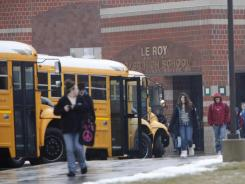 Mystery: Students walk Thursday at Le Roy High School in New York, where several teens have exhibited unusual symptoms.