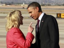 Arizona Gov. Jan Brewer points at President Obama on Wednesday.