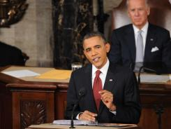 President Obama delivers the State of the Union address as Vice President Joe Biden looks on.
