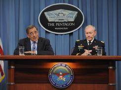 Defense Secretary Leon Panetta and Joint Chiefs Chairman Gen. Martin E. Dempsey outline the main areas of proposed spending cuts during a Thursday news conference at the Pentagon.