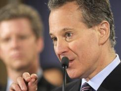 New York Attorney General Eric Schneiderman speaks Friday at the Justice Department in Washington.