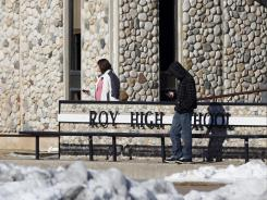 Students exit Roy High School Friday in Roy, Utah. A plan to detonate an explosive at the school was foiled when a student reported a strange text to a school administrator.