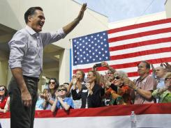 Former Massachusetts governor Mitt Romney campaigns in Naples, Fla., on Sunday.