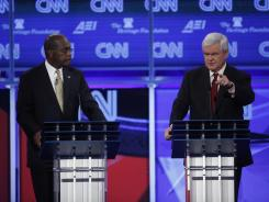 Herman Cain and former House Speaker Newt Gingrich are seen during the Nov. 22, 2011, Republican presidential debate in Washington. Cain dropped out of the race and has endorsed Gingrich.