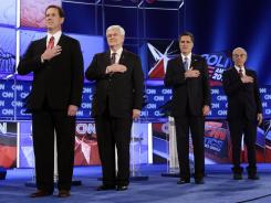 The GOP presidential candidates stand during the National Anthem at the Republican presidential debate in Jacksonville on Thursday.