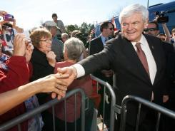 Former House speaker Newt Gingrich greets supporters during a campaign rally Sunday at a retirement community in Lady Lake, Fla.