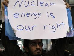 Iranian students protest during the arrival of a team of International Atomic Energy Agency inspectors.