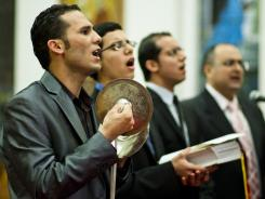 Mina Bouls worships with other Coptic Christian deacons at St. George Coptic Orthodox Church in Philadelphia on Orthodox Christmas Eve.