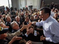 Republican presidential candidate Mitt Romney greets people during a rally Monday at the Ring Power Lift Trucks in Jacksonville.