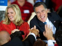 Mitt Romney and wife, Ann, greet supporters at his election night headquarters in Tampa.