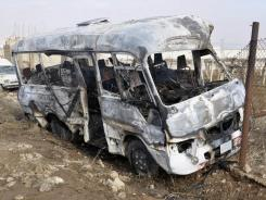 Syrian authorities say this burned bus was caused by a &quot;terrorist group&quot; near Damascus.