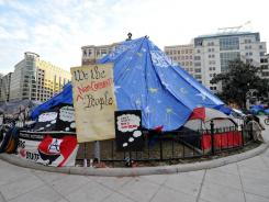 Occupy signs remain at McPherson Square in Washington, D.C., on Tuesday.