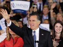GOP presidential hopeful Mitt Romney waves to supporters in Tampa after winning the GOP primary.
