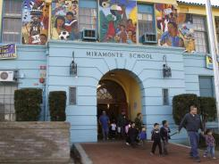 Students leave Miramonte Elementary school after classes Tuesday in Los Angeles. Veteran Miramontes Elementary school teacher Mark Berndt, 61, was arrested Monday on charges of lewd conduct with 23 children.