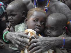 Refugees: Victims of ethnic violence wait in line at a food distribution center in Pibor, South Sudan, a newly created nation.